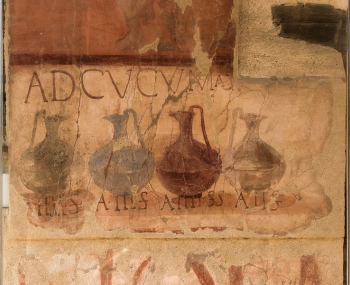 """Ad Cucumas"" shop, ancient roman painting in Herculaneum, Italy."